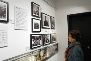 Visitors are watching the pictures on exhibition.