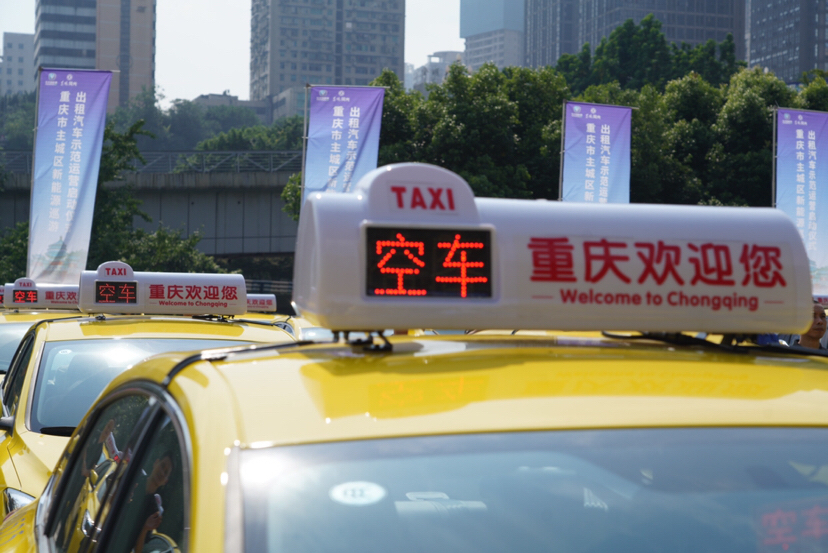 """New taxis with """"empty car"""" light on the top"""