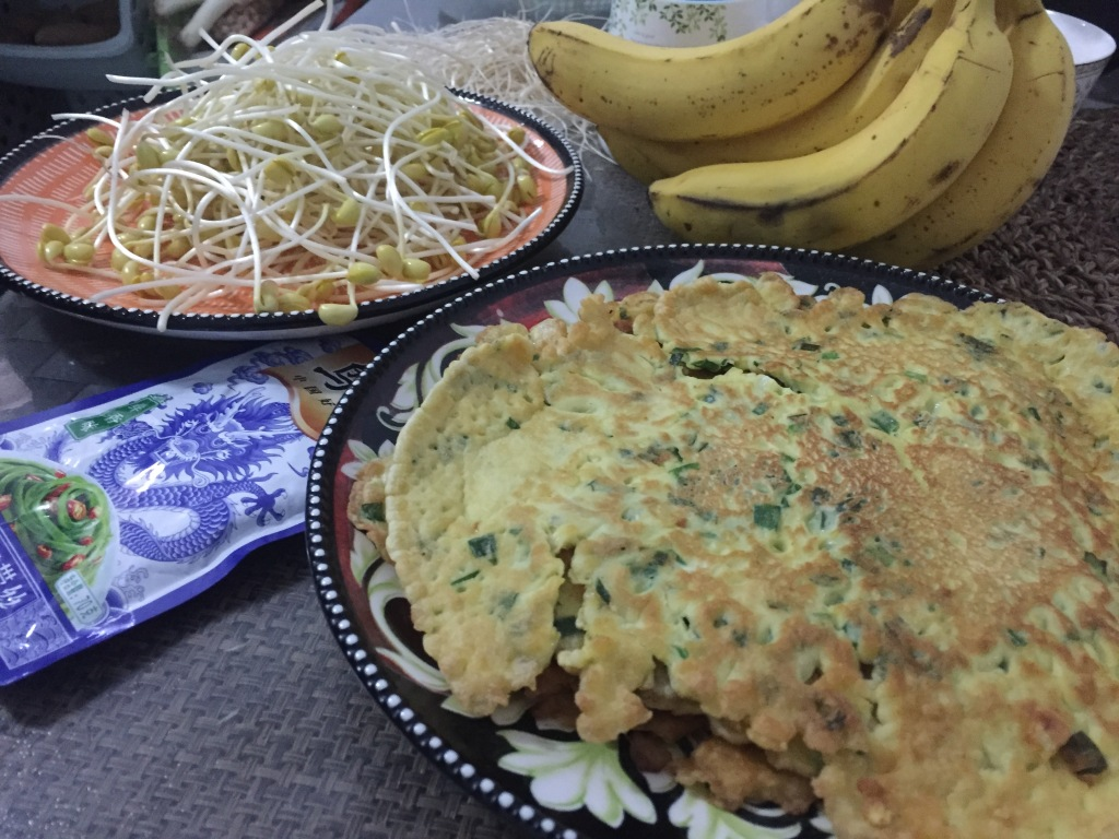 Delicious pancakes and fresh sprouts.