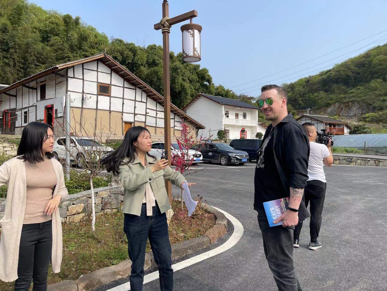 Walking with Xiaosu from Xinhau and local leader, Wu Xianli in peaceful Da Tianchi village, Yubei